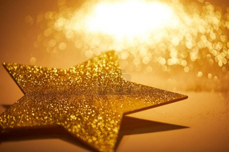 golden shiny star for christmas decoration on tabletop