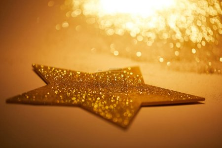 selective focus of golden shiny star for christmas decoration