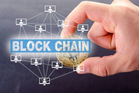 block chain concept, male hand holding bitcoin