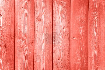 wooden texture background. Color of the year 2019 Living Coral.